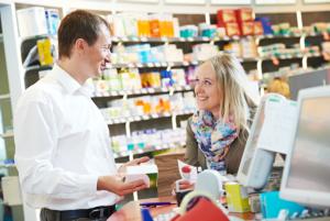 drug information identification pharmacist assisting his clients - Drug Information Pharmacist